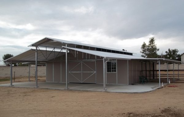 raised-center-aisle-ring-o-steel-horse-barn-with-end-and-side-porches